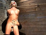 Little blond Aussie chick gets bound in a unique rope prison.  Hands taped and bound, she is stripped, flogged, and made to cum! So helpless