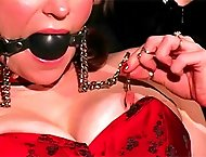 Gagged babe has her nipples clamped and her pale white skin beat red by her harsh mistress