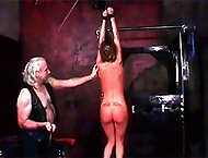 Abused slave`s body is covered in welts and red marks as she shows them off to her master
