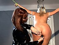 Kinky lesbians Aloha and Roxx in bound spanking set in latex