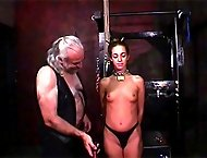 A locked collar makes sure that this slave can`t get away from her master`s hard flogging