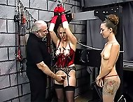 Sexy slave has her nipples and pussies clamped and pulled on while her ass is paddled hard