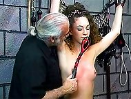 Lash marks all over this slave`s body show you the harsh torture she`s gone through here