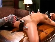 Asian girl is tied to a table by her master so he can attach suction to her nipples and pussy